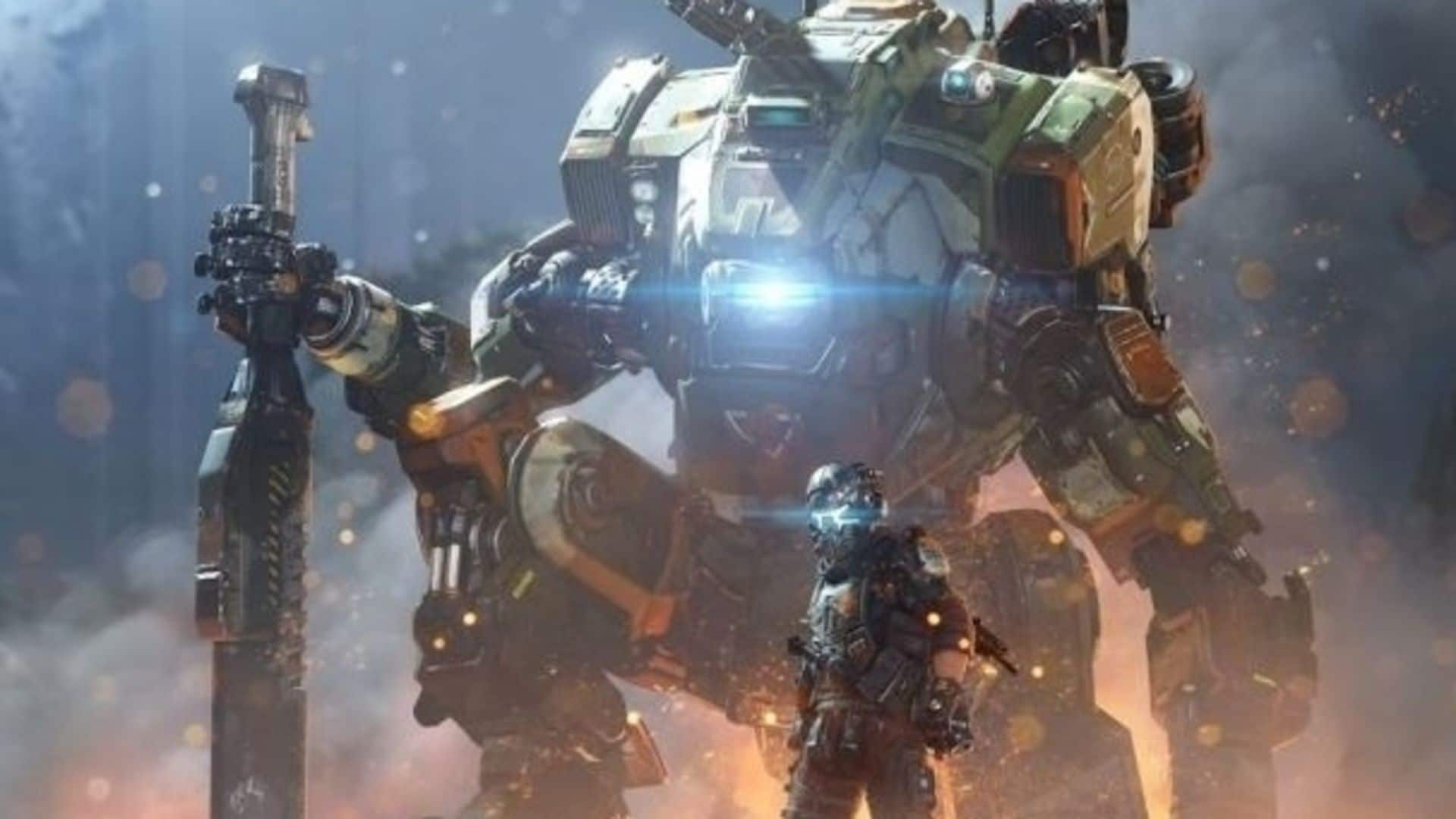 EA - Titanfall; Personagem do game à frente, robô gigante, chamado de titã, ao fundo com luzes nos olhos em posição de batalha com o ambiente destruído ao redor.