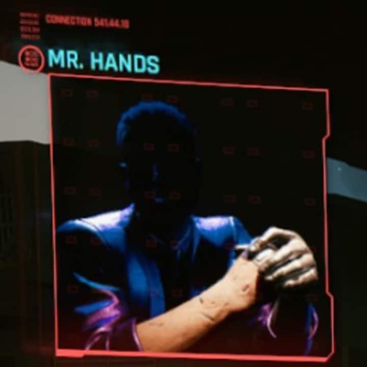 Suposto novo personagem da DLC de Cyberpunk 2077, que só aparece com as mãos e tem o rosto escuro em tom de mistério.