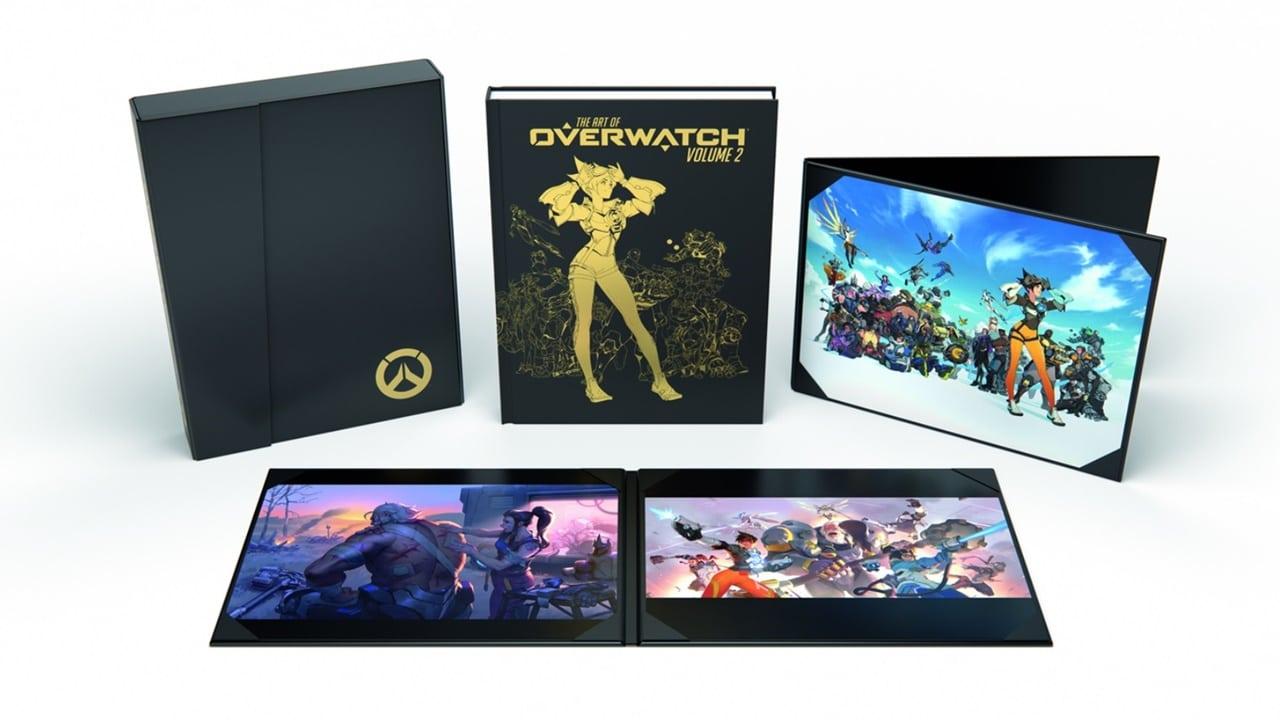 Itens do novo artbook de Overwatch, que incluem encartes de capa dura e mini-pôster.