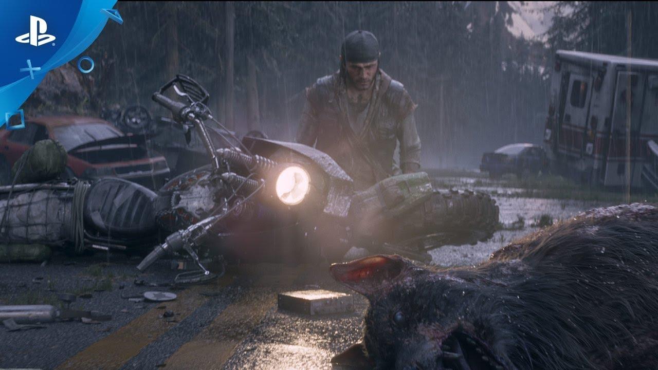 Deacon, protagonista de Days Gone, da Bend Studio, de joelhos em uma estrada chuvosa com uma moto tombada e lobos mortos.