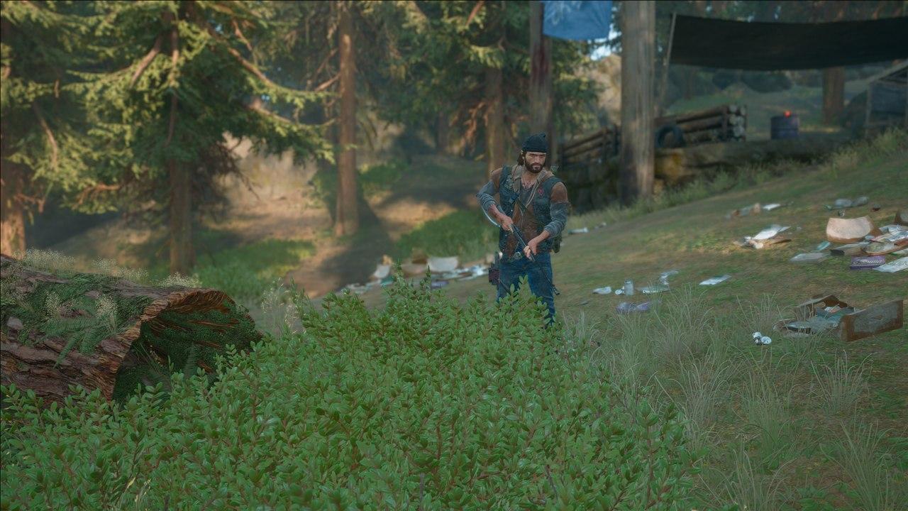 Imagem do protagonista de Days Gone para PC segurando uma arma em uma floresta