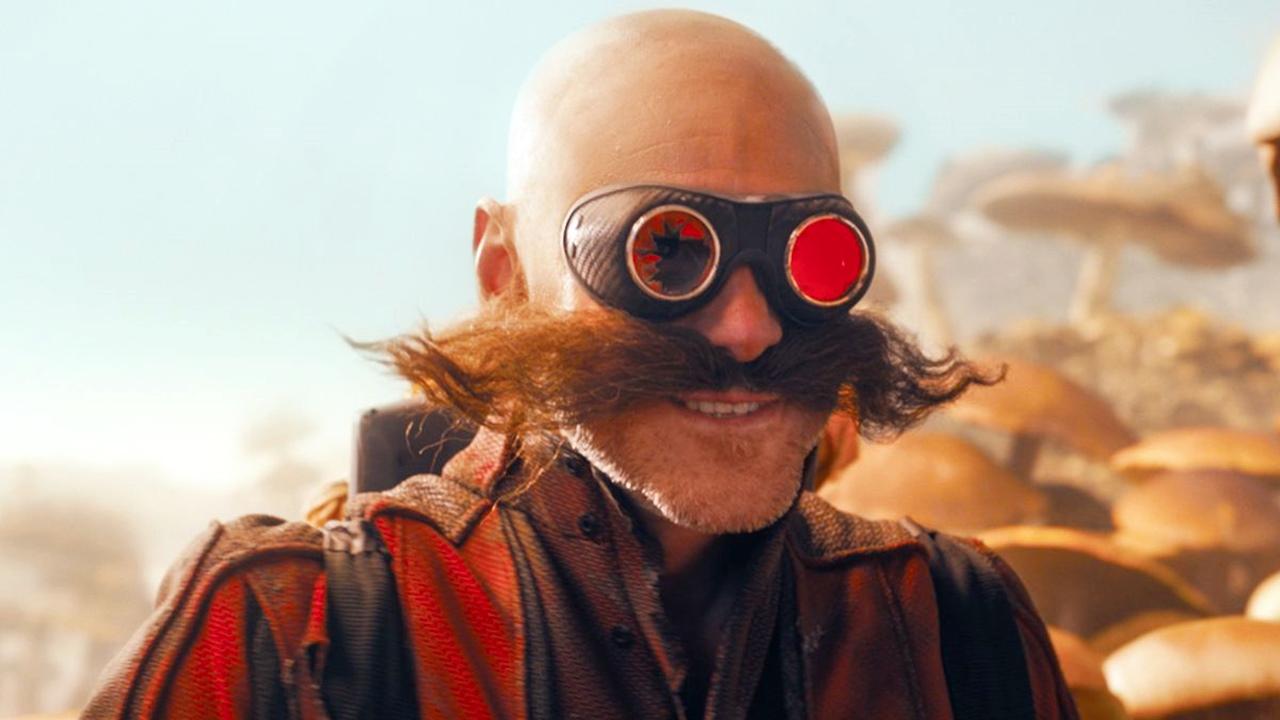 Dr Eggman em Sonic 2, com óculos de lente vermelha quebrada e fundo cheio de cogumelos gigantes.