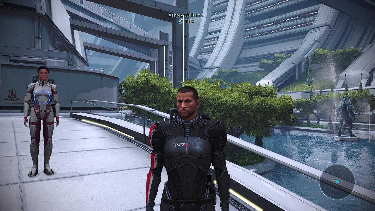 Personagens do jogo Mass Effect Legendary Edition, um homem e uma muher,parados em cima de uma ponte.