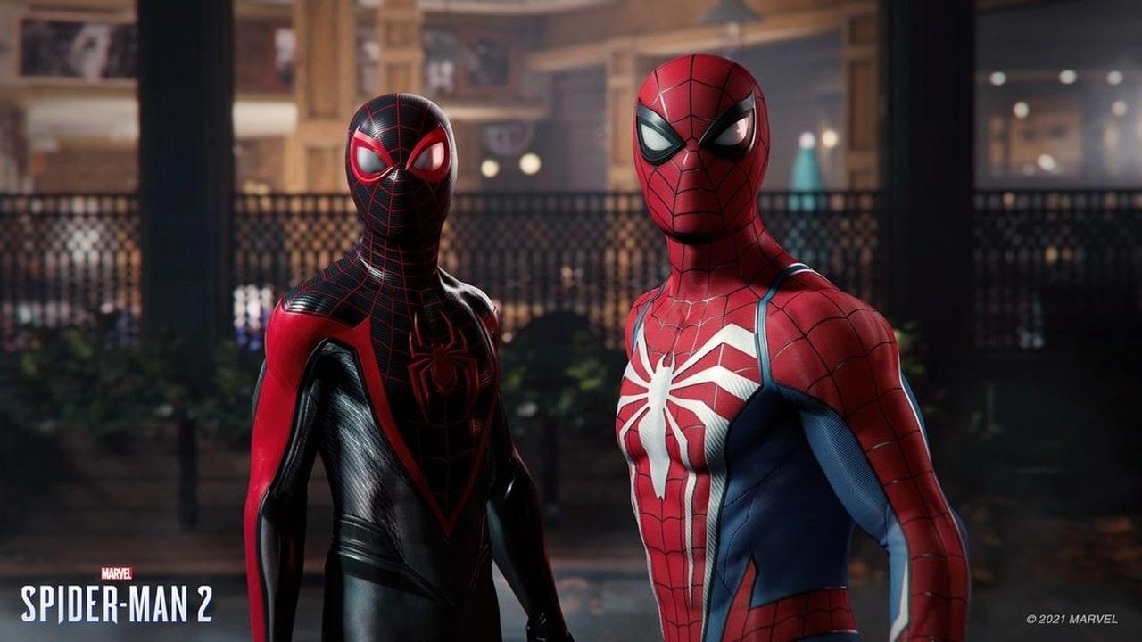 Imagem de capa de uma captura do Trailer de Marvel's Spider-Man 2 com Peter Parker e Miles Morales em destaque com seus trajes de Homem-Aranha